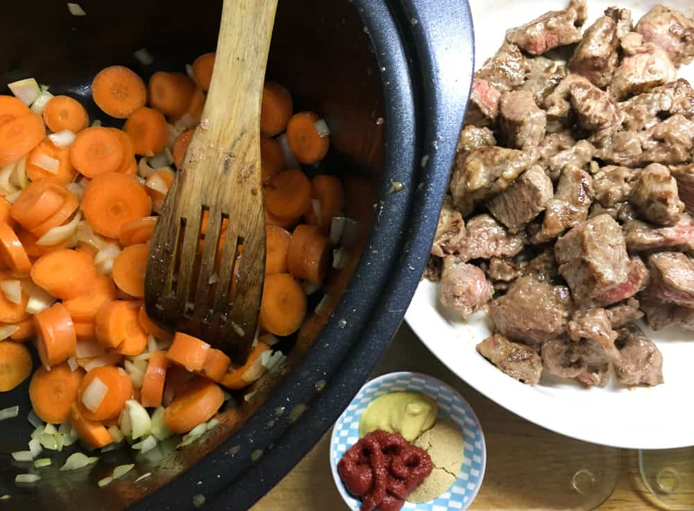 The Best Crockpot Beef Stew and Dumplings with carrots and onion